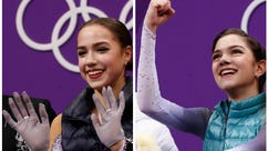 In this combination of photos, Russian athletes Alina Zagitova, left, and Evgenia Medvedeva react as their scores are posted following their performance in the women's short program figure skating in the Gangneung Ice Arena at the 2018 Winter Olympics in Gangneung, South Korea, Wednesday, Feb. 21, 2018. They will compete for the gold in the free skate Friday, Feb. 23. (AP Photos/Bernat Armangue)