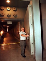 Marvin Weikle swings open a massive door which covers