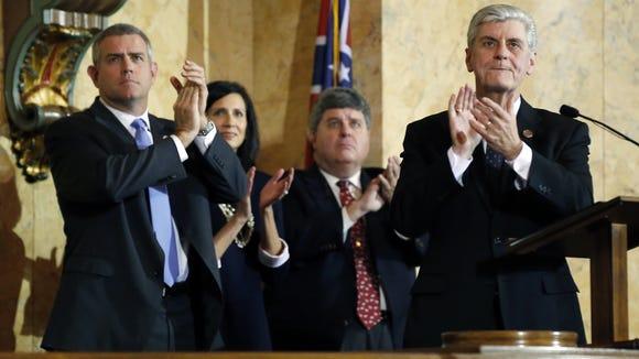 Republican Gov. Phil Bryant, right, leads fellow Republicans