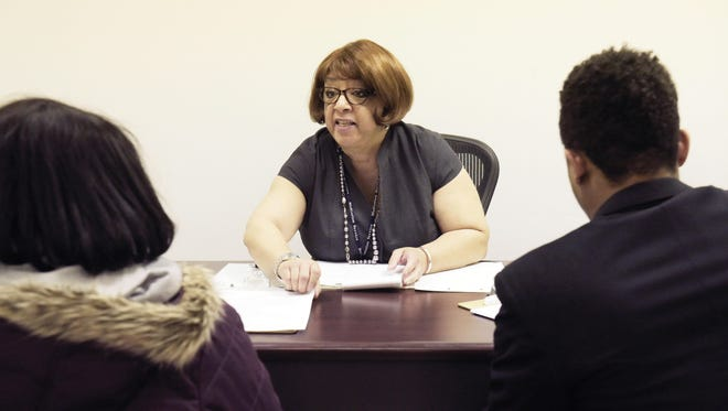 Court mediator Mary Morris mediates a small claim with two clients inside her office.