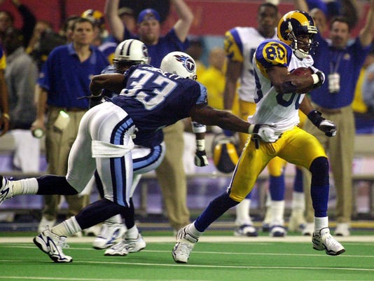 FILE - In this Jan. 30, 2000, file photo, St. Louis Rams wide receiver Issac Bruce (80) runs 73 yards for a touchdown as Tennessee Titans safety Anthony Dorsett (33) tries to tackle him during the fourth quarter of NFL football's Super Bowl XXXIV in Atlanta. The Rams won 23-16. (AP Photo/John Bazemore, File)