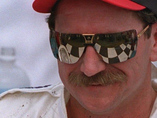Dale Earnhardt Sr. celebrates in victory lane after winning the International Race of Champions in 1995 in Daytona Beach, Fla.