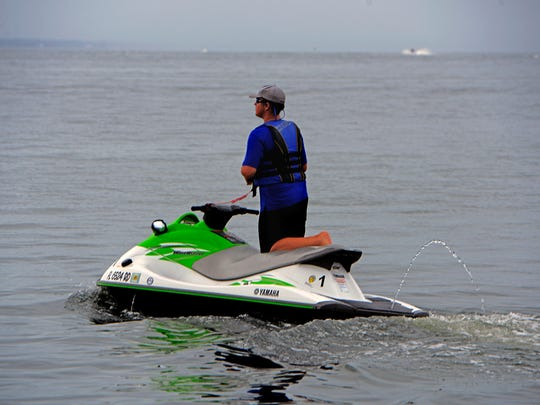 A customer leaves Radical Rides on a WaveRunner Sunday afternoon.