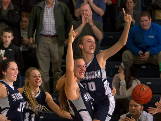 Marina Mabrey holds up sister Dara as they celebrate their Group Championship over Westwood. Manasquan vs Westwood in Girls Group 2 Championship on March 15, 2015 in Toms River. Peter Ackerman/Staff Photographer