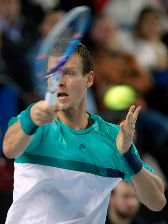 Tomas Berdych of Czech Republic returns to Nick Kyrgios of Australia, during their semi final match, at the Open 13 Provence tennis tournament, in Marseille, southern France, Saturday Feb.20 , 2016.(AP Photo/Claude Paris)
