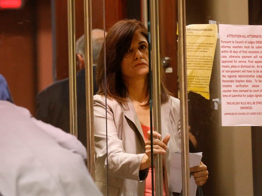 Myrna Gamboa exits the courtroom after being sworn in to testify later during the Texas Education Agency hearing for three former Bowie High School administrators who were in court fighting possible sanctions or the revocation of their educator's credentials over their alleged roles in the EPISD cheating scheme. The three former administrators are former Bowie Principal Jesus Chavez and former Assistant Principals Anna Luisa Kell and Juan Manuel Duran.