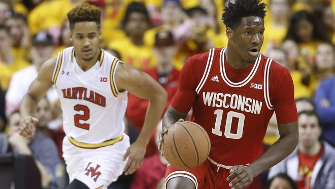 Wisconsin forward Nigel Hayes, right, drives down the court past Maryland guard Melo Trimble during a game in February. Hayes has decided to enter the NBA 2016 draft.