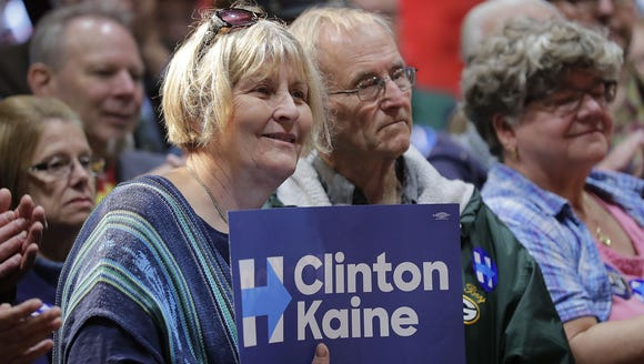 Supporters in the audience listen as Chelsea Clinton,