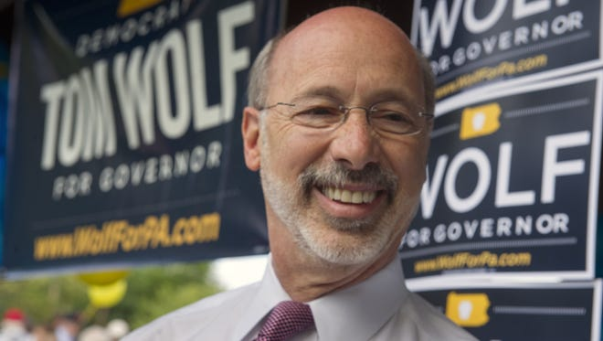 In this file photo, Tom Wolf talks to the media after a rally in Mount Wolf in 2014.