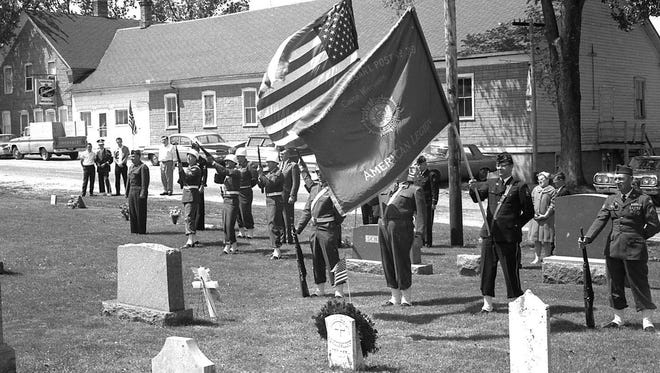 SNAPSHOT IN TIME: Casco's American Legion Thibaudeau-Drossart Post No. 319 was paying tribute to military veterans at Slovan when Harold Heidmann snapped the photo on Memorial Day 1965.  The longtime post had its start after World War I and was originally named for Clarence Thibaudeau, who was killed in action. Always active sponsoring community and youth activities, Thibaudeau-Drossart raised funds with performances of minstrel shows and other events. Each Memorial Day found the post honoring the dead at cemeteries in places such as Rosiere, Lincoln, Slovan and Casco Village.  The photo comes from the Heidmann Collection at Algoma Public Library.