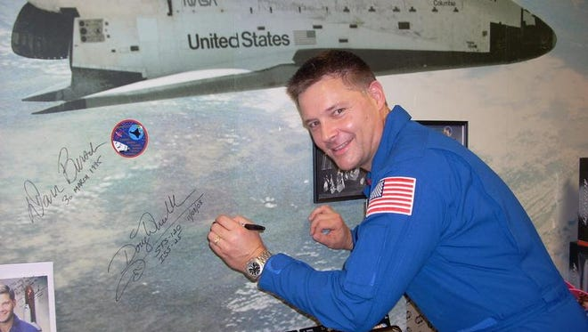 Astronaut and Windsor native Col. Douglas Wheelock signs the Kopernik Observatory and Science Center Wall of Fame on a previous visit.
