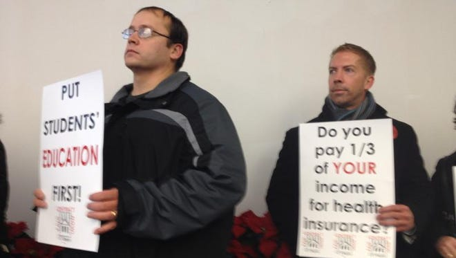 Members of the American Association of University Professors at UC protest during a 2013 board of trustees meeting.