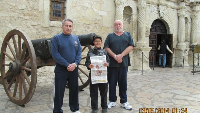 (From left) John M. Mazzeo of Milmay; his 11-year-old grandson, Damien Rodriquez of Vineland; and his longtime hunting buddy Curt Pierson of Bridgeton visited the Alamo in San Antonio after a successful predator hunt in Eagle Pass, Texas. Damien harvested a wild boar at 102 yards and a javelina at 122 yards.