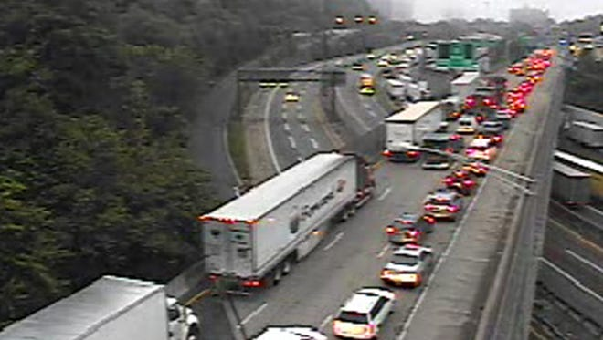 This image provided by the New Jersey Department of Transportation shows the traffic backup at 5:56 a.m. Thursday June 12, 2014, following a fatal accident that  closed the upper level into New York City on the George Washington Bridge. This camera is located on Route 4 at the I-95 approach to the George Washington Bridge. The Port Authority says that the trucks crashed shortly before 2:30 a.m. Thursday closing the upper level into New York City on the GWB. (AP Photo/NJ DOT)