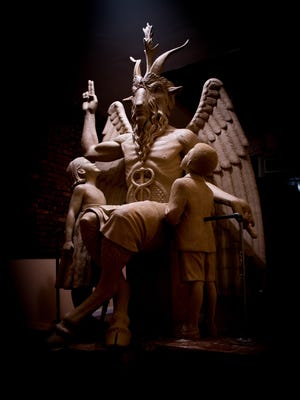 This July 6, 2015 file photo provided by The Satanic Temple shows the sculpture an 8½-foot-tall bronze monument featuring Satan was cast from in New York.