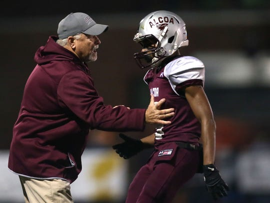 Alcoa coach Gary Rankin talks with Diandre Johnson during a semifinal game against Red Bank last season. Alcoa won 34-0.