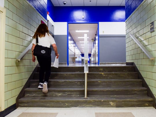 A student walks up one of the many sets of stairs at