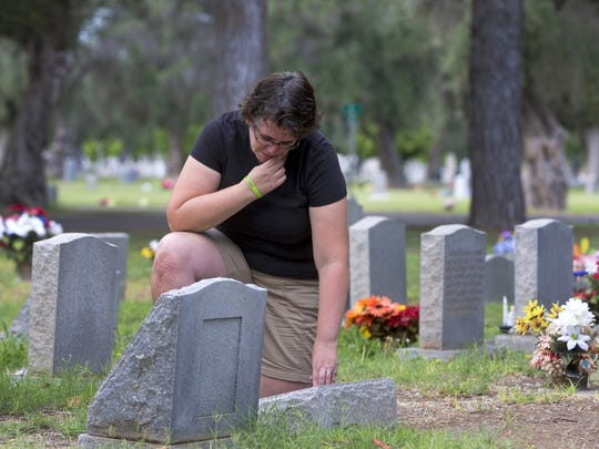 Nicole Hayes visits the grave site of her infant daughter, Samantha, at the Mesa Cemetery on July 1, 2016. Hayes lives in Gilbert and supports building a Gilbert cemetery so that residents don't have to travel to other cities.