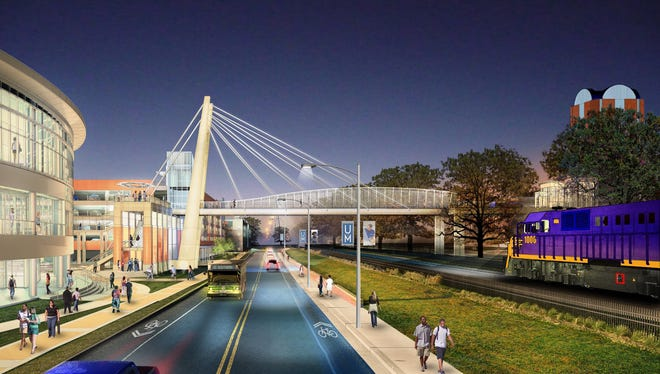 An artist's rendering shows the proposed pedestrian bridge to be built on the University of Memphis campus.