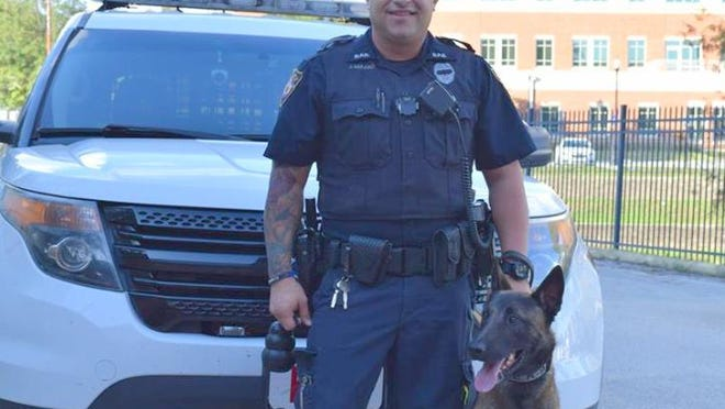 Joey Mulero was fired as a DeLand police officer Monday for excessive use of force and not having probable cause to make an arrest. He's shown with K-9 Officer Ruso.