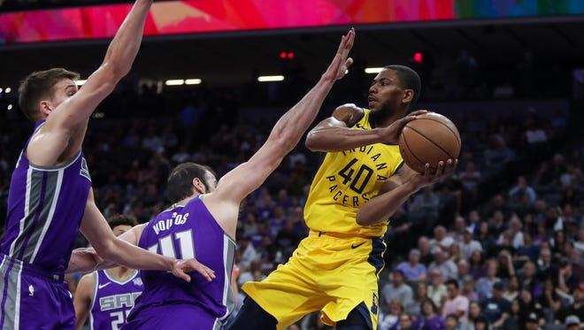 Pacers guard Glenn Robinson III (40) passes the ball around Sacramento Kings center Kosta Koufos (41) and guard Bogdan Bogdanovic (8) during the first half at Golden 1 Center.
