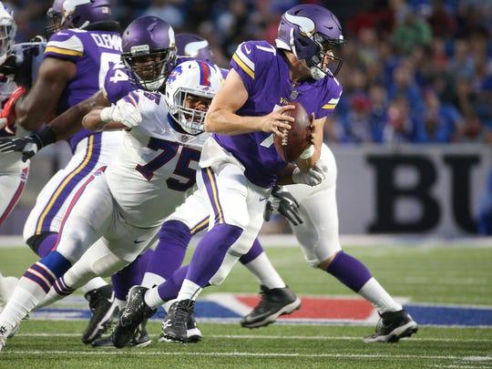 The Bills' Eddie Yarbrough  gets the sack against the Vikings' Case Keenum.