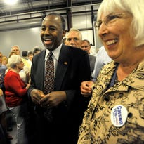 Presidential candidate Ben Carson makes his way through the crowd before speaking at the Faith and Freedom Rally hosted by congressman Mark Meadows at the WNC Agricultural Center on Tuesday.