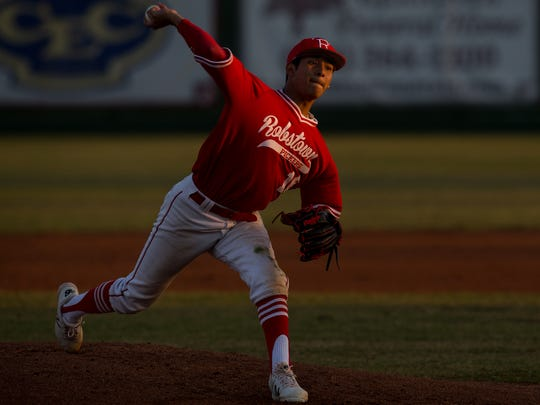 Robstown's Jacob Garcia throws a pitch during the first inning of their game against Sinton at Sinton High School on Friday, March 16, 2018.