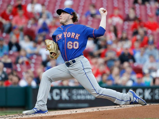 New York Mets starting pitcher P.J. Conlon throws in the first inning of a baseball game against the Cincinnati Reds, Monday, May 7, 2018, in Cincinnati.