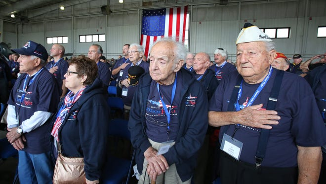 WWII veterans Chick Galella of Sleepy Hollow, right, and Julious Schultz of West Harrison at Westchester County Airport Oct. 18, 2014. The veterans were on their way to Washington D.C. on a chartered plane as part of the Hudson Valley Honor Flight program.
