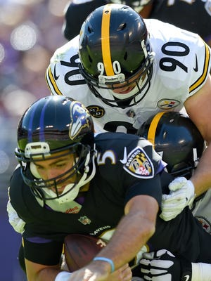 Baltimore Ravens quarterback Joe Flacco (5) is sacked by Pittsburgh Steelers outside linebacker T.J. Watt (90) and defensive end Stephon Tuitt (91) last season. The Ravens-Steelers rivalry is traditionally one of the heated in the NFL. AP FILE PHOTO