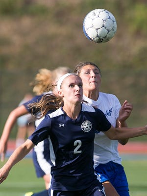 Dallastown's Lyndee Anders (2), shields off a Spring Grove defender during the first half of a York-Adams girls' soccer game Thursday, Sept. 15, 2016, at Papermakers Stadium in Spring Grove. Dallastown won 4-0. Amanda J. Cain photo