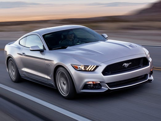 The redesigned 2015 Ford Mustang GT coupe. The GT model gets 5-liter V-8 rated 435 hp, 400 lbs.-ft. of torque. Car's due in showrooms in October starting at about $24,000.