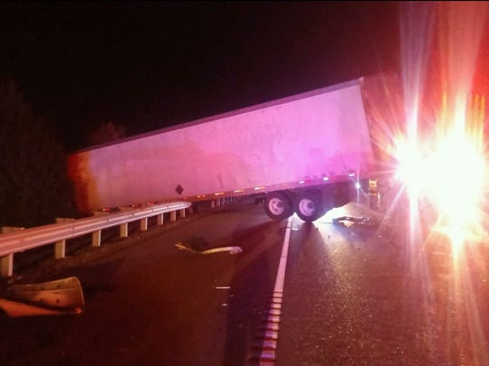 A tractor-trailer went through a guardrail after it was hit by a car on State Route 69 in Decatur County on Friday.