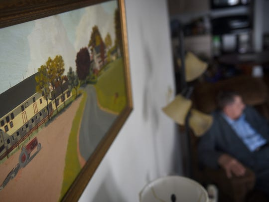 Raymond and Mary Eshleman recently celebrated their 70th anniversary. A painting of the the farm they once lived on is hung above the mantel of their apartment at Lebanon Valley Brethren Home in North Londonderry Township.