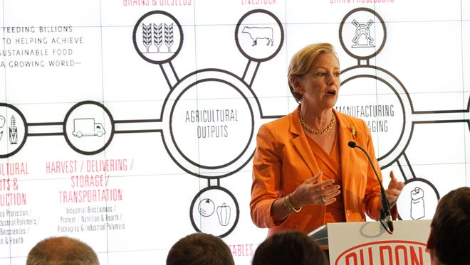 "DuPont CEO Ellen Kullman addresses a crowd of more than 100 people at the opening of the DuPont Johnston Innovation Center in 2013. Kullman last week called Trian's proposal to split DuPont and Pioneer a high-risk move that would ""destroy shareholder value."""