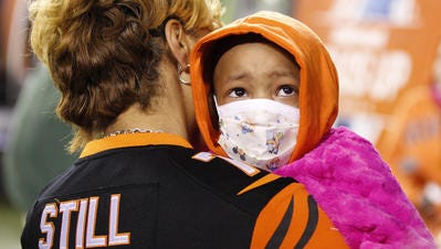 Leah Still listens as fans call her name while she leaves the field during the Cincinnati Bengals-Cleveland Browns game at Paul Brown Stadium Thursday. Nearly $1,350,000 was donated to cancer in Leah's honor.