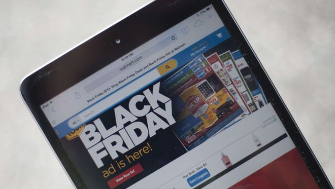 "A ""Black Friday"" advertisement for Walmart is seen on an iPad in Annapolis, Maryland November 16, 2014. ""Black Friday"" is coming early this year to retailers, as many plan to open on November 27, Thanksgiving Day."