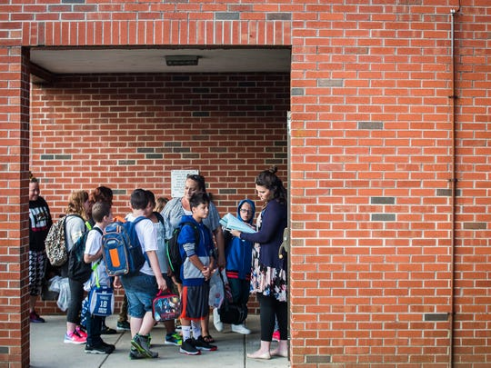 Parents and students arrive at South View Elementary