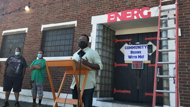 Pastor and former Erie City Councilman Curtis Jones Jr. announces plans to turn a building at 759 E. 22nd St. that formerly housed the Club Energy after-hours club into a community facility to benefit residents in the neighborhood during a news conference outside the club on Wednesday morning.