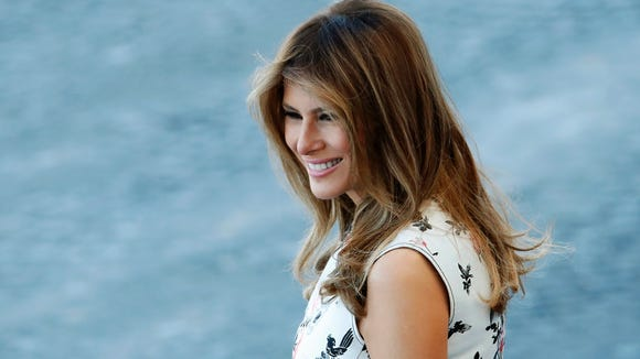 Melania Trump is all smiles during the traditional