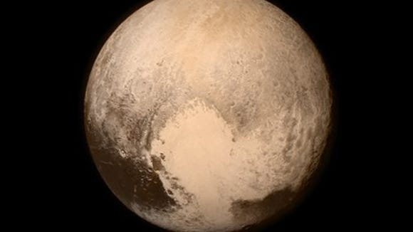 This July 13, 2015 image provided by NASA shows Pluto from the New Horizons spacecraft.  The United States is now the only nation to visit every single planet in the solar system. Pluto was No. 9 in the lineup when New Horizons departed Cape Canaveral, Fla, on Jan. 19, 2006