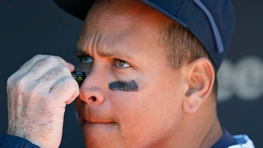 New York Yankees designated hitter Alex Rodriguez has eye black applied before an opening day baseball game between the Yankees and the Houston Astros in New York, Tuesday, April 5, 2016.