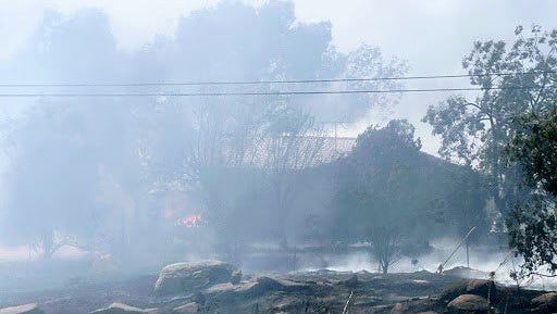 """The """"Navajo Fire"""" broke out at about 10:40 Monday morning just west of Perris, destroying at least one home and several vehicles."""
