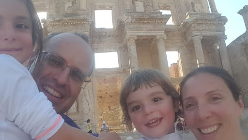 Patricia Abad and her family in front of the Library of Celsus, an ancient Roman building in Ephesus, Anatolia, now part of Selçuk, Turkey.