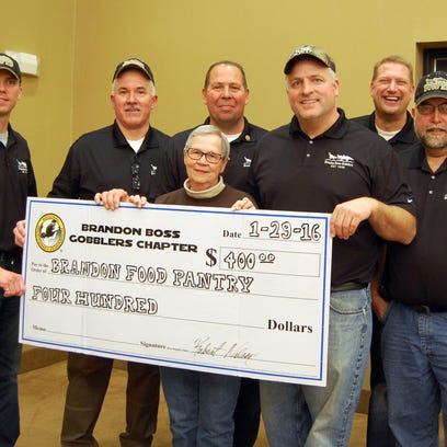 The Brandon Boss Gobblers Chapter of the National Turkey Federation helped out another local non-profit, the Brandon Area Food Pantry, with this donation of $400. Chapter members presenting the check to BAFP executive director Linda Weber are, from left: Gabe Laber, Bob Nelson, Travis Kasten, Matt Swenson, Todd Winkel and Tom Senske. The donation to the BAFP and other events the Boss Gobblers carry out, are the proceeds from group's main fundraiser of the year, their annual banquet, where silent and live auction items are sold.