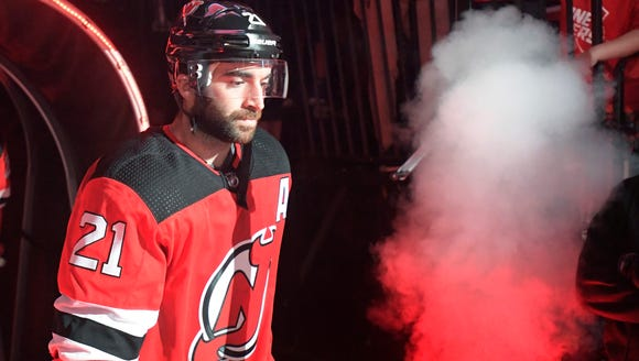 New Jersey Devils right wing Kyle Palmieri (21) comes