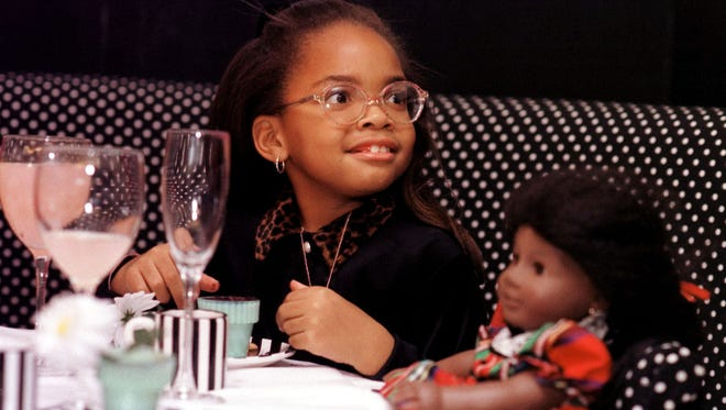 Brittany Ducksworth, 7, has tea with her doll Addy in the cafe at the American Girl Place in Chicago.