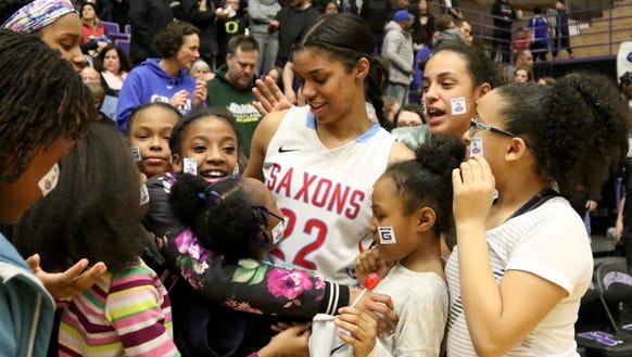 South Salem's Evina Westbrook (22) is congratulated