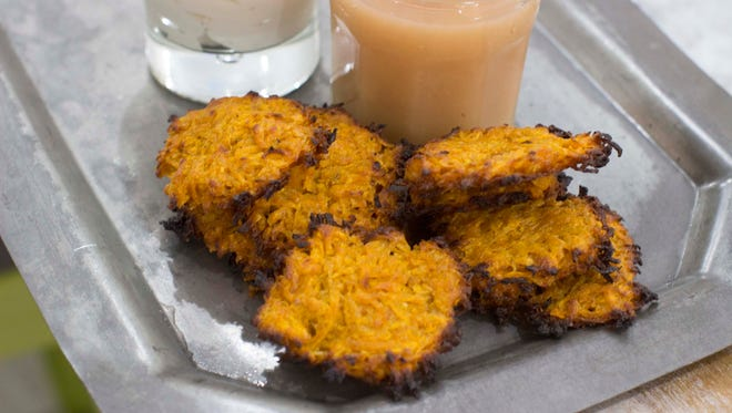 Smoky sweet potato latkes in Concord, N.H. on Nov. 10, 2014. Sweet potato latkes are delicious and crispy and perfect accompanied by unsweetened applesauce and plain Greek yogurt or sour cream.